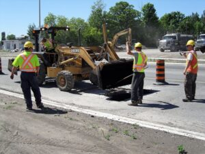 Drain Bros. patching Landsdowne Street in Peterborough